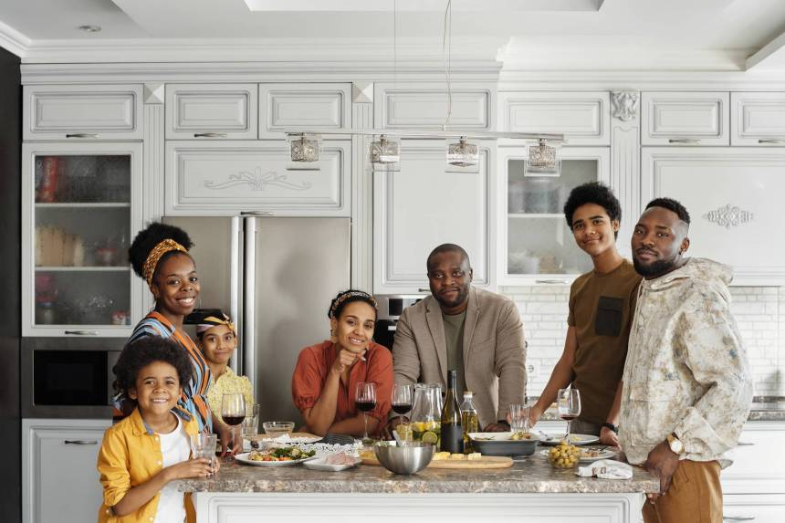family posing for a photo in the kitchen